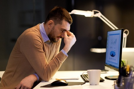 tired businessman working at night office Stock Photo