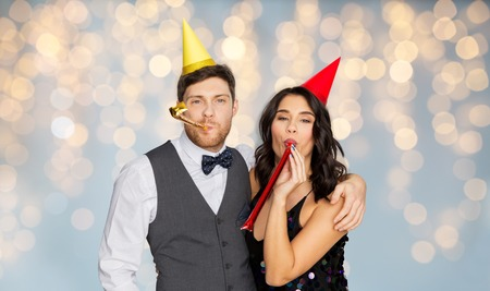happy couple with party blowers having fun Foto de archivo
