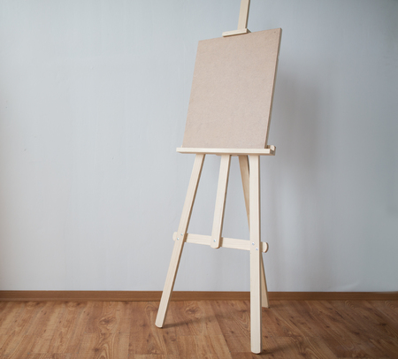 wooden easel at art studio