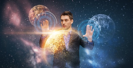 businessman with virtual planets and space