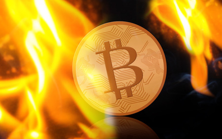 gold bitcoin on fire over black background Stock Photo