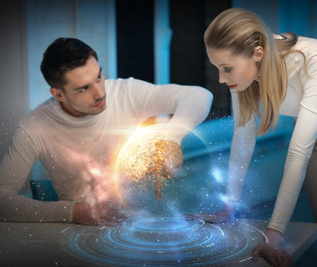 couple using touch screen over space background