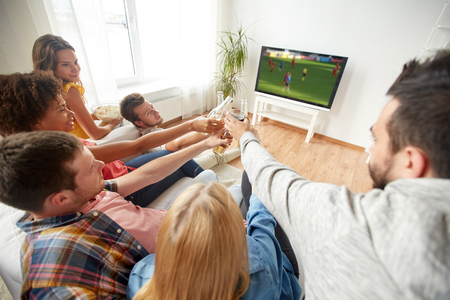 friends with beer watching football or soccer game