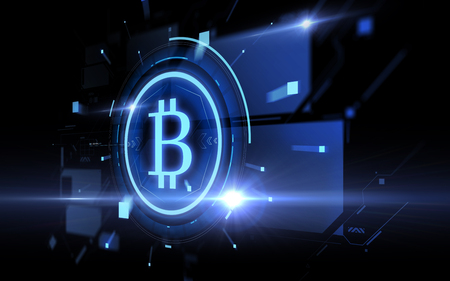 blue bitcoin projection over black background Stock fotó - 95035893