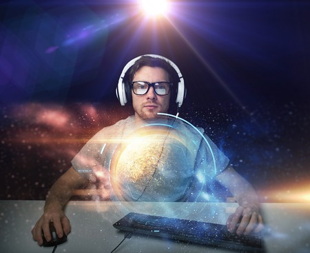 man in headset playing computer video game