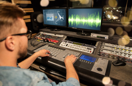 man at mixing console in music recording studio Stock Photo - 95035961