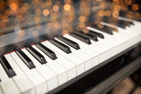 close up of grand piano keyboard
