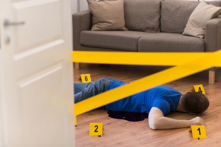 dead man body in blood on floor at crime scene