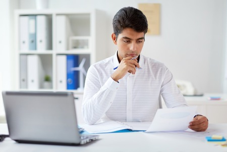 businessman working with papers at office 免版税图像