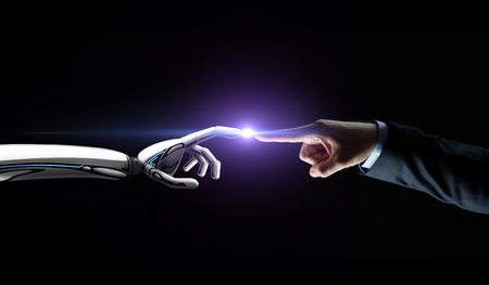 robot and human hand connecting fingers