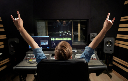 man at mixing console in music recording studio Stock Photo - 95139301