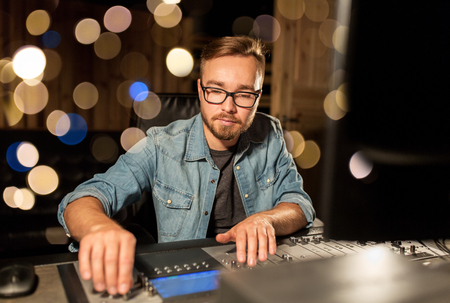 man at mixing console in music recording studio Stock Photo - 95139302