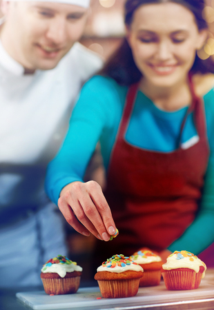 happy woman and chef cook baking in kitchen Stock Photo
