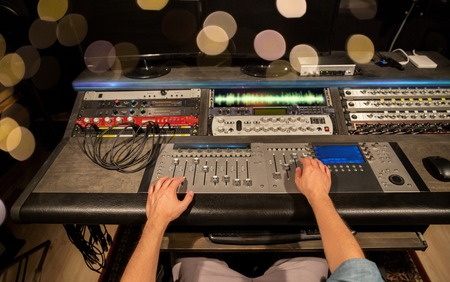 man using mixing console in music recording studio Stock Photo - 95260206