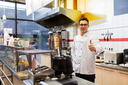 chef at kebab shop showing thumbs up Stock Photo - 95260341