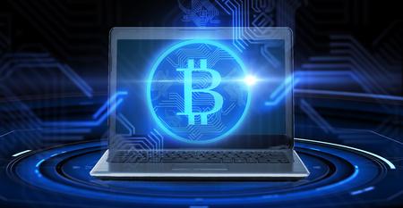 laptop computer with bitcoin hologram Stock fotó - 95427706