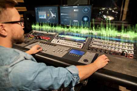man at mixing console in music recording studio Stockfoto