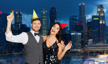 happy couple party in night singapore city Stock Photo