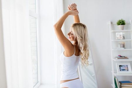 young woman in underwear stretching at home window Stock fotó