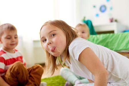 girl showing tongue at home
