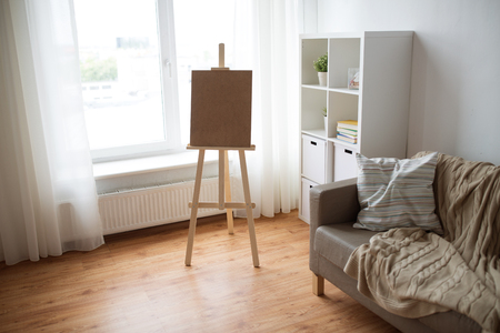 wooden easel at home room or art studio Imagens