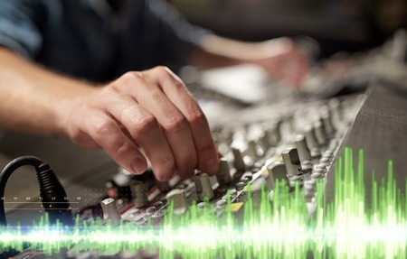 hands on mixing console in music recording studio Stock Photo - 95485417