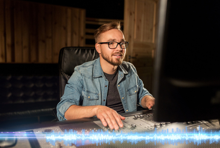 man at mixing console in music recording studio Stock Photo - 95485418