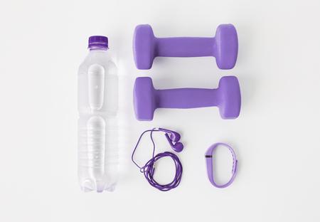 dumbbells, fitness tracker, earphones and bottle