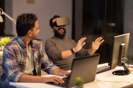 creative man in virtual reality headset at office