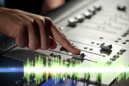 hands on mixing console in music recording studio Stock Photo - 95654676