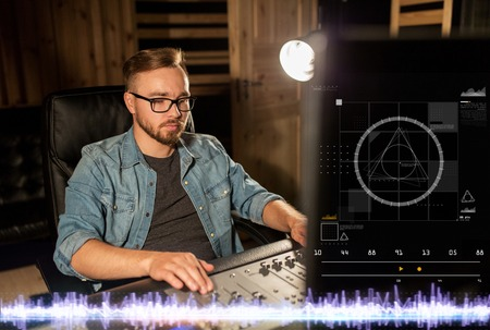 man at mixing console in music recording studio Stock Photo
