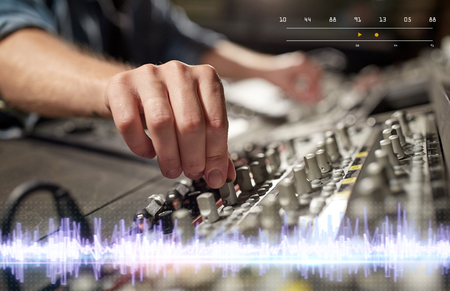 hands on mixing console in music recording studio Stock Photo - 95793094