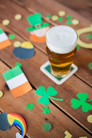glass of beer and st patricks day decorations