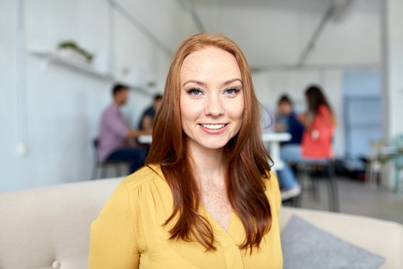 happy creative female worker at office or student Stock Photo