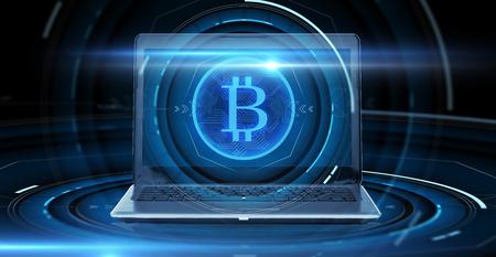 laptop computer with bitcoin hologram Stock fotó - 96033275