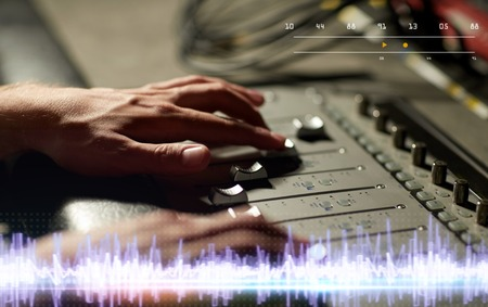hands on mixing console in music recording studio Stock Photo - 96033432