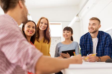 creative team talking at office Stockfoto