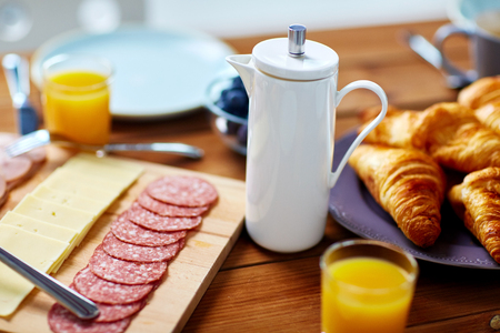 coffee pot and food on served table at breakfast
