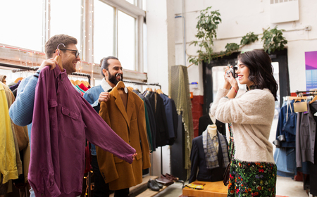 friends photographing at vintage clothing store