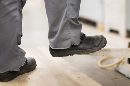 close up of male worker feet in working shoes 스톡 콘텐츠