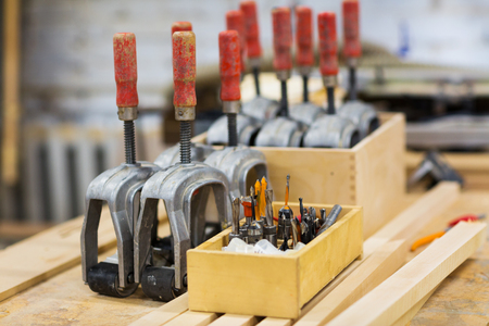 drills and woodworking tools at workshop