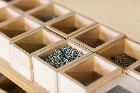 screws in wooden boxes at workshop Archivio Fotografico - 96116805