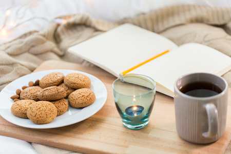 cookies, tea and candle in holder at home