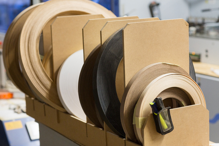 veneer or edge band tapes at woodworking factory 스톡 콘텐츠