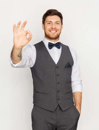 happy man in festive suit showing ok hand sign