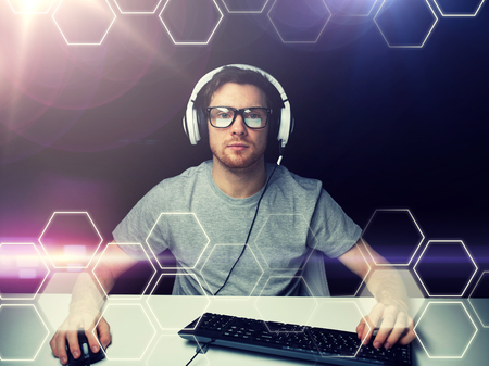 492d255dd154 man in headset computer over hexagons projection Stock Photo
