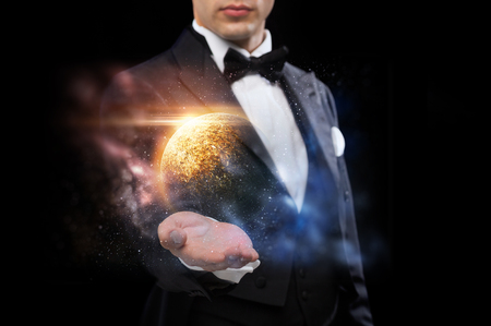 male magician with planet and space hologram Stock fotó