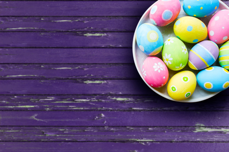 close up of colored easter eggs on plate Stock Photo