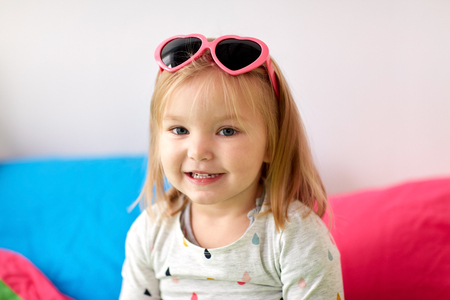 portrait of smiling little girl with sunglasses