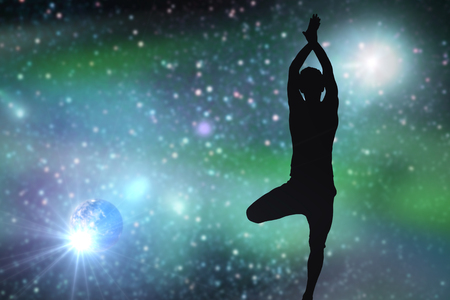 silhouette of man making yoga over space Stock Photo